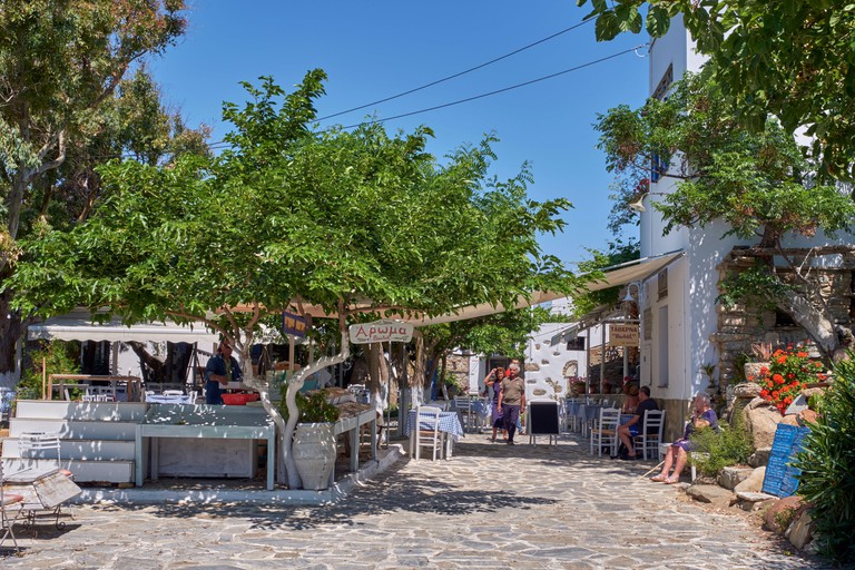 TX8AEB Taverna and craft stall in the village of Volakas. Tinos, Greece.