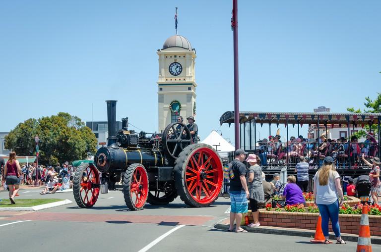 Steam Traction Engine at  Feilding, Manawatu, North Island, New Zealand.  Clock tower behind.