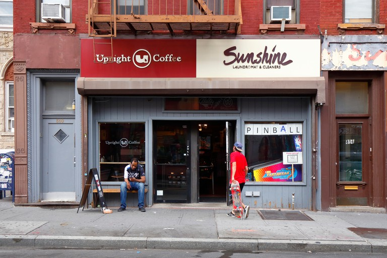 Upright Coffee, Sunshine Laundromat, 860 Manhattan Avenue, Brooklyn, NY. exterior of a coffee shop, and a laundromat with pinball games in Greenpoint.. Image shot 07/2019. Exact date unknown.