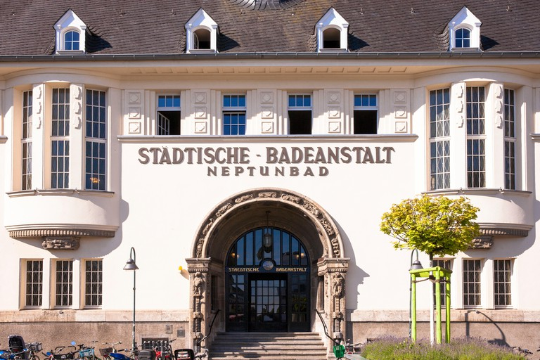 portal of the swimming baths Neptunbad in the district Ehrenfeld, Cologne, Germany.Portal des Neptunbad im Stadtteil Ehrenfeld, Koeln, Deutschland.