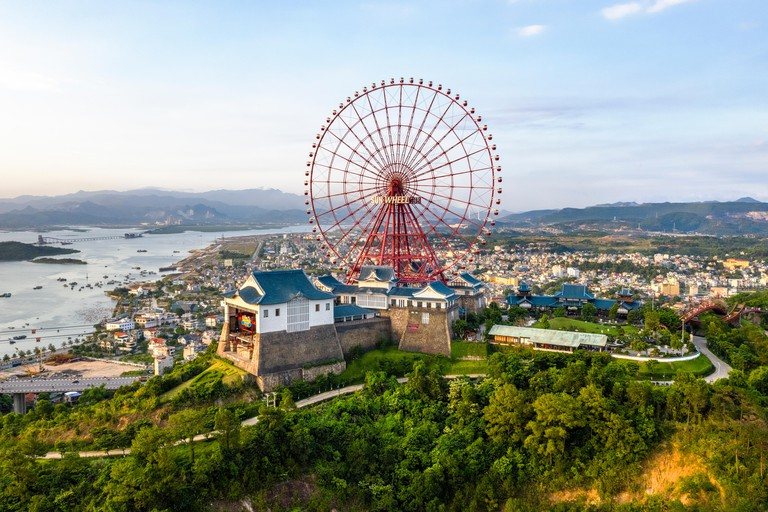 Panorama of Ha Long City, Vietnam, with Bai Chay bridge and Sun Wheels  Near Halong Bay, UNESCO World Heritage Site.