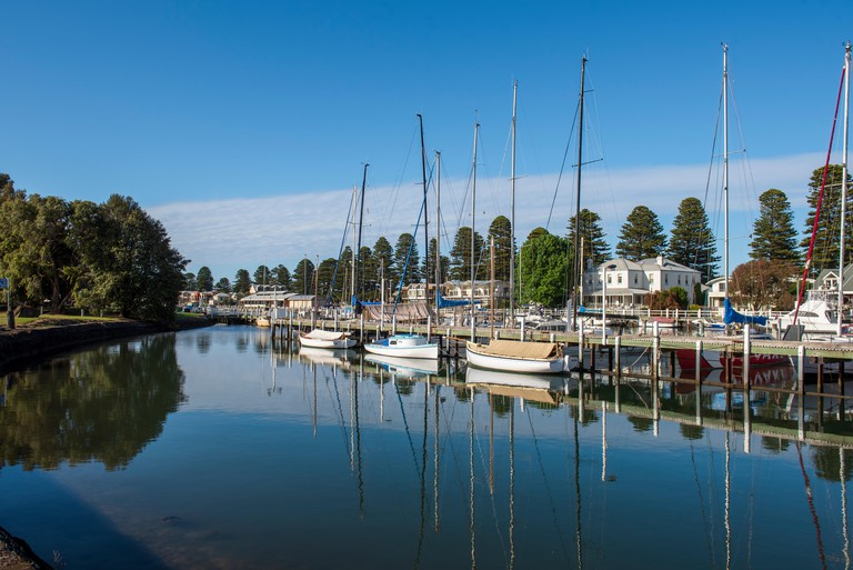 Boats moored on the Moyne River at Port Fairy on the Great Ocean Road  Victoria Australia