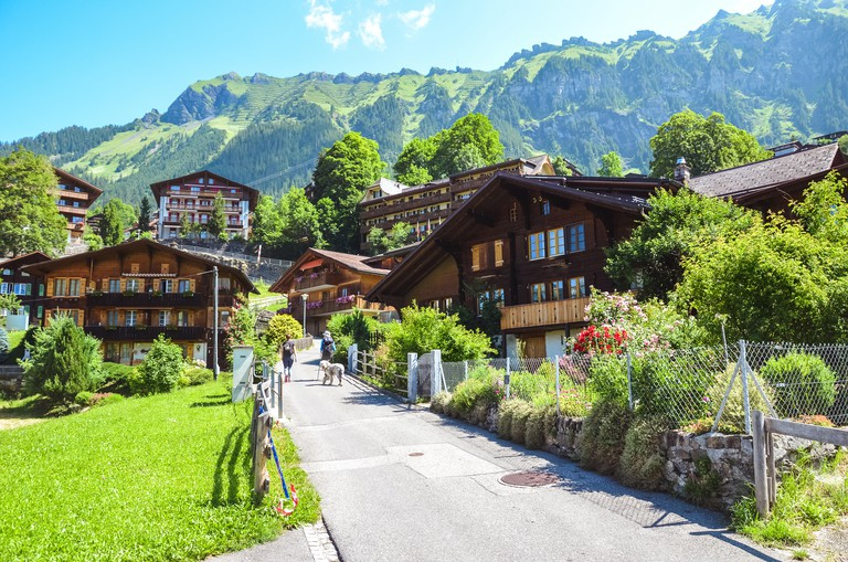 W40B97 Picturesque Alpine village Wengen in Switzerland in summer season. Mountain chalets, hikers and green hilly landscape. Swiss Alps. Switzerland in summer. Alpine landscape.