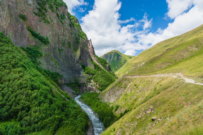Truso Valley and Gorge area landscape on trekking / hiking route, in Kazbegi, Georgia. Truso valley is a scenic trekking route