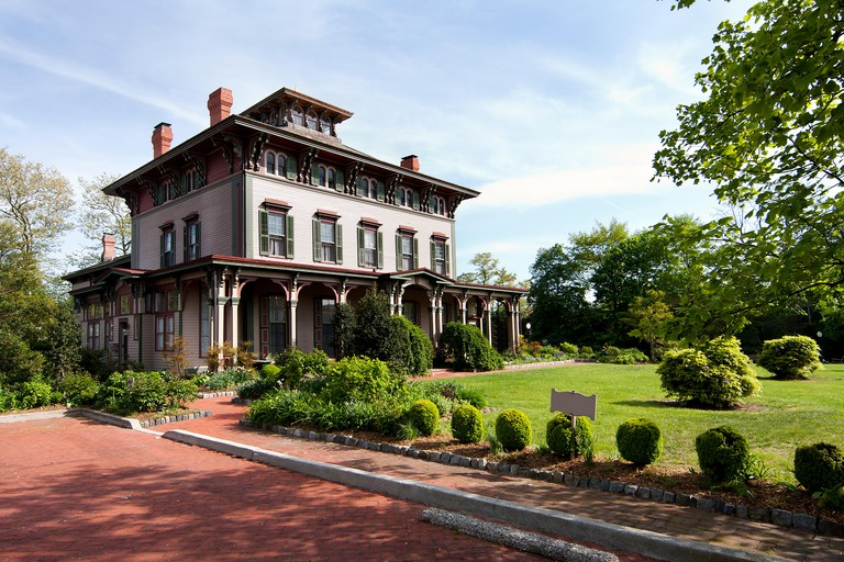 The Southern Mansion in Cape May, NJ, built with historic Victorian architecture, with garden yard.
