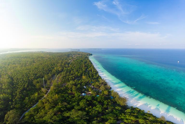 Aerial view tropical beach island reef caribbean sea at Pasir Panjang, Kei Islands, Indonesia Moluccas archipelago. Top travel destination, best divin