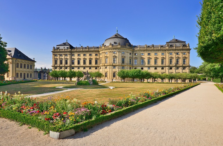 Germany, Bavaria, Wurzburg, Wurzburg Residenz or Residence Palace, Hofgarten or Court Garden, View from the South Garden including sculpture titled Th
