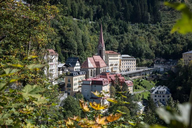 View of Preims church and hotels, health resort Bad Gastein in Gasteinertal, Salzburg, Austria