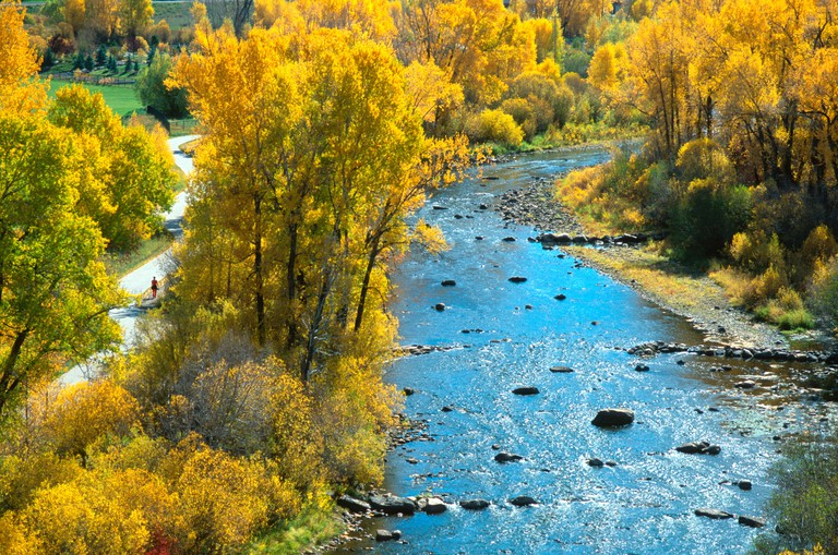 Yampa river core trail meandering beside the Yampa river in fall Steamboat Springs Colorado USA