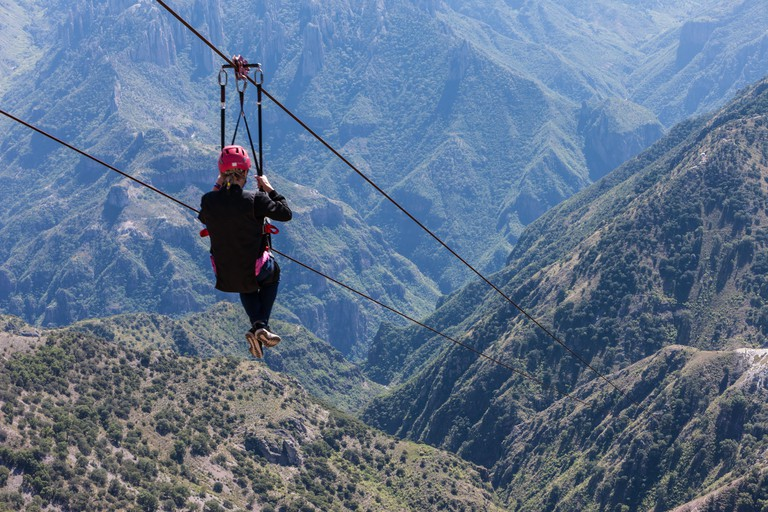 Ziplining at Divisadero, Copper Canyon, Chihuahua, Mexico.  8350 feet long, longest zip line in the world.  Speed may reach 70 mph on the descent.