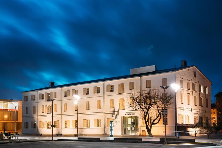 Parnu, Estonia. Building Of Parnu Museum In Evening Or Night Illuminations.