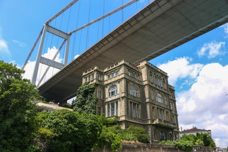 Old historic waterfront mansion called Tophane Musiri Zeki Pasa Mansion under Bosphorus Bridge, Bosphorus Strait - Istanbul