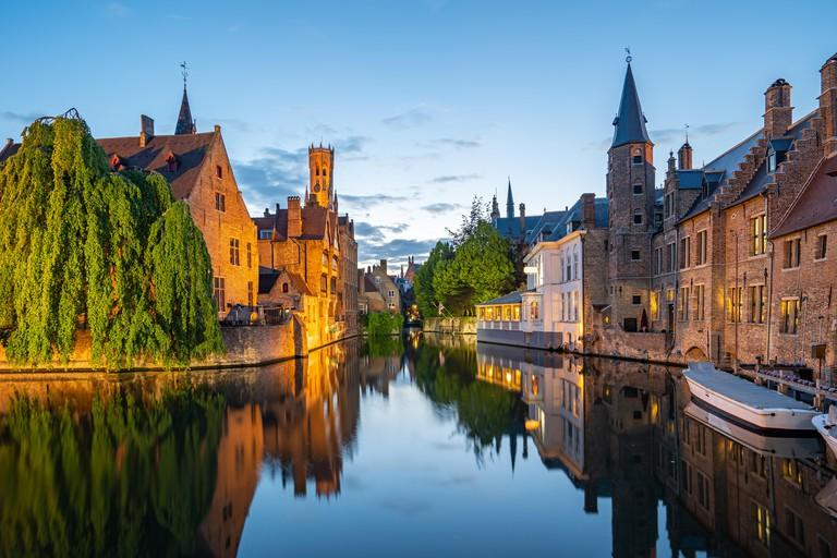 Bruges skyline with old buildings at twilight in Bruges, Belgium.