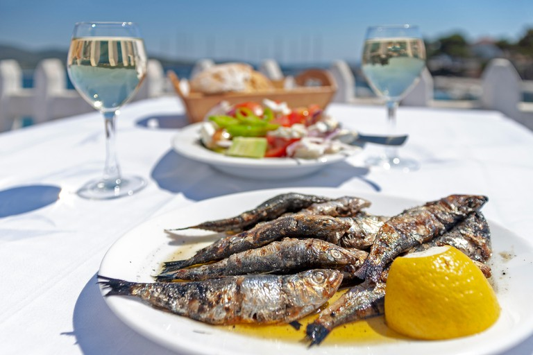 Greek food served in a pavement restaurant in Chalcidice, Greece.