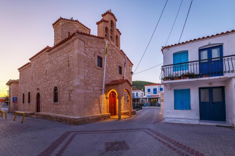 Megalochori, Greece - November 03, 2019: Church in the main square of Megalochori village on Agistri island in Greece.