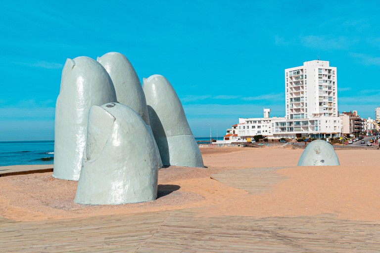 2A8H884 Punta del Este, Uruguay. August 28, 2018. La Mano (The Hand) is a sculpture in Punta del Este by Chilean artist Mario Irarrazabal.