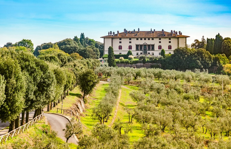 Artimino, Tuscany, Italy, amazing landscape view of beautiful landmark Medici Villa La Ferdinanda or Cento Camini facade amongst green olive trees