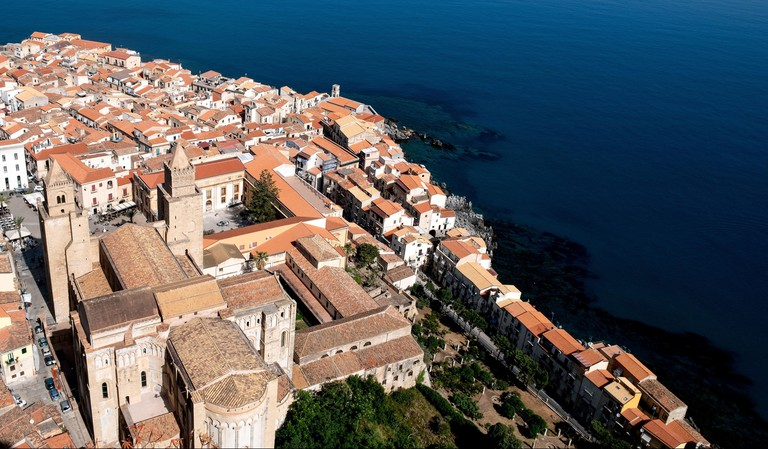 Elevated view of Cefalu Old Town centred around the catholic cathedral or Duomo of Cefalu in Sicily, Italy.