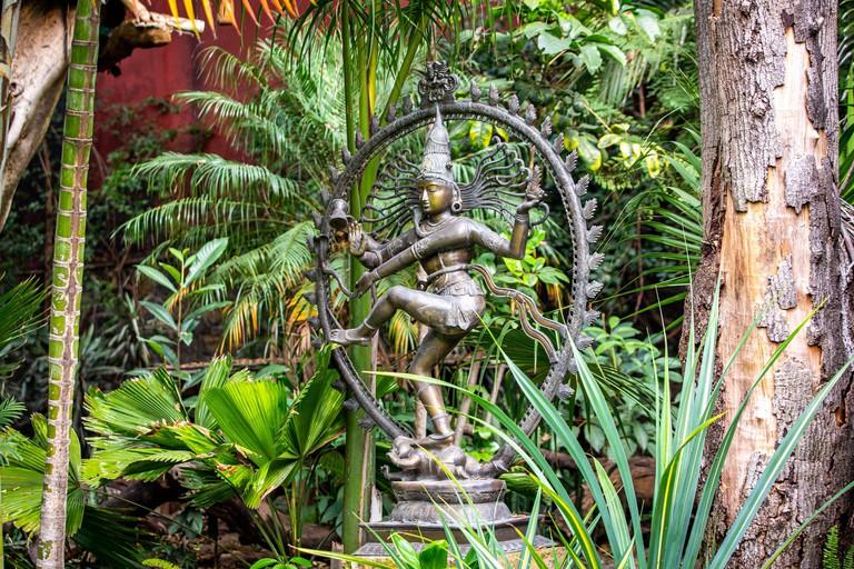 Metal statue if hindu goddess kali in the garden outdoor