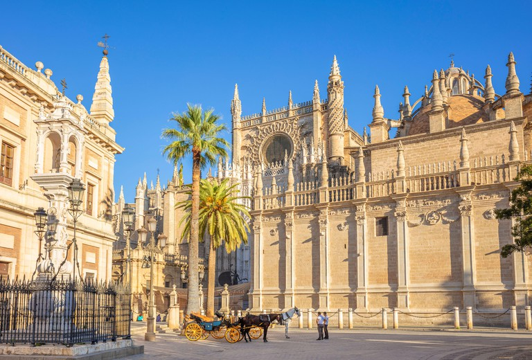 Carriage rides offered outside Seville Cathedral and the General Archive of the Indies building, UNESCO, Seville, Andalusia, Spain