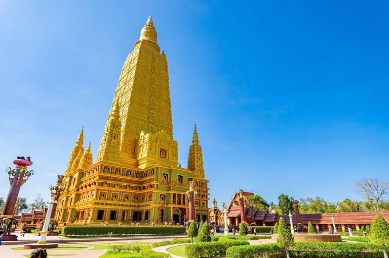 Krabi, Thailand - 30 December 2019 - Tourists and locals visit Wat Mahathat Watchiramongkhon, or locally known as Wat Bang Thong in Krabi, Thailand on