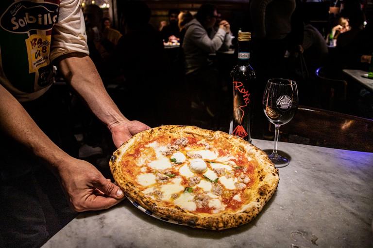 Spicy Italian Sausage and buffalo mozzarella Pizza at Sorbillo's Pizzeria, Naples, italy