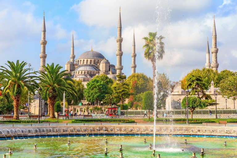 The Blue Mosque and the fountain in Sultan Ahmet park, Istanbul, Turkey.