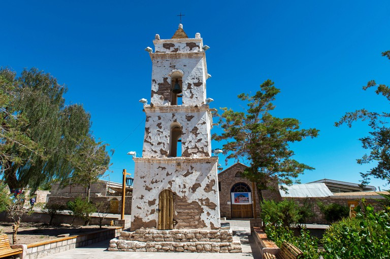 The bell tower of San Lucas in the oasis town of Toconao near San Pedro de Atacama in the Atacama Desert, northern Chile, dates back to 1750 and is se