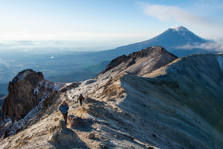 Two people climbing Iztaccihuatl volcano in Mexico