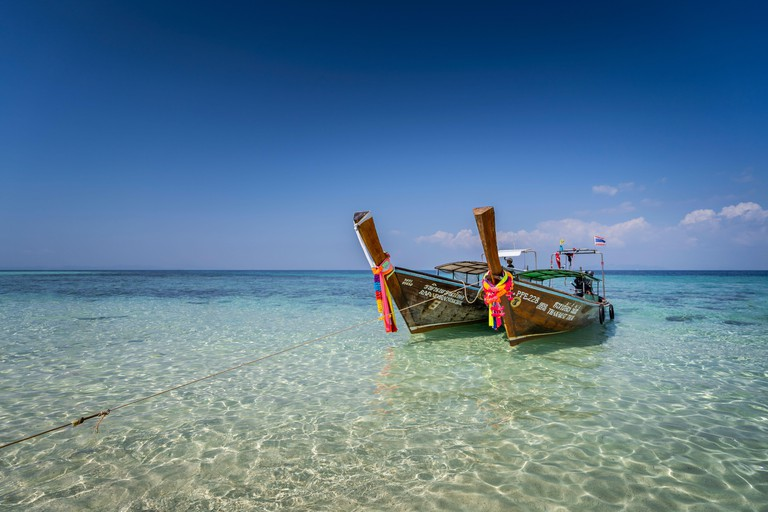 Amazing Blue Water at Bamboo Beach, Maya Bay with long tail boats, Phi Phi Lay Island, Krabi Province, Thailand