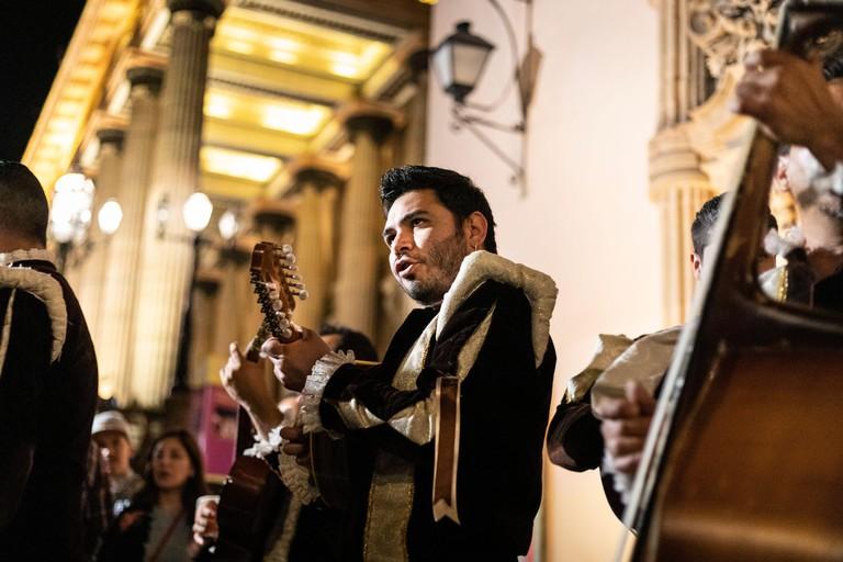 Troubadodours entertain a crowd near the Benito Juarez Theater in the historic downtown of Guanajuato, Mexico.