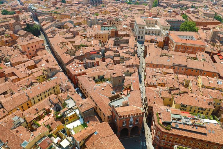 Amazing Bologna Aerial Cityscape. Beautiful view of the italian medieval city of Bologna with Piazza della Mercanzia square, Italy.