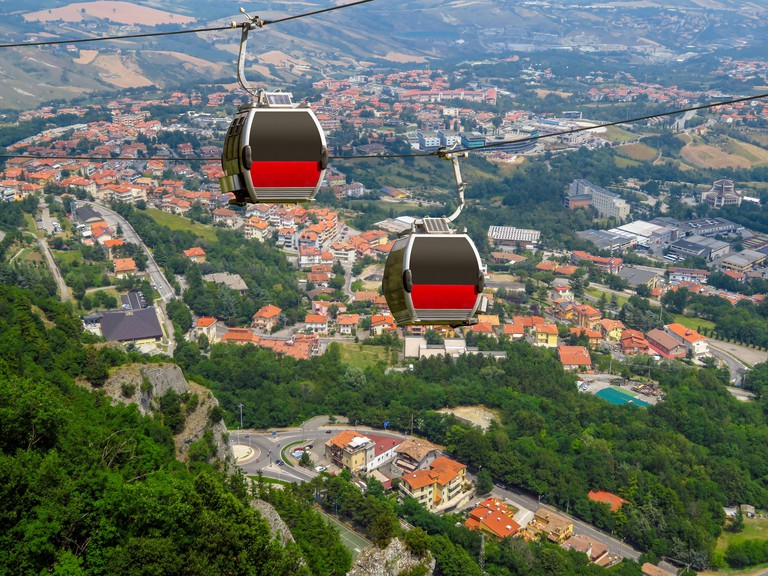 Two cabins of the funicular over the village from the fortress of San Marino