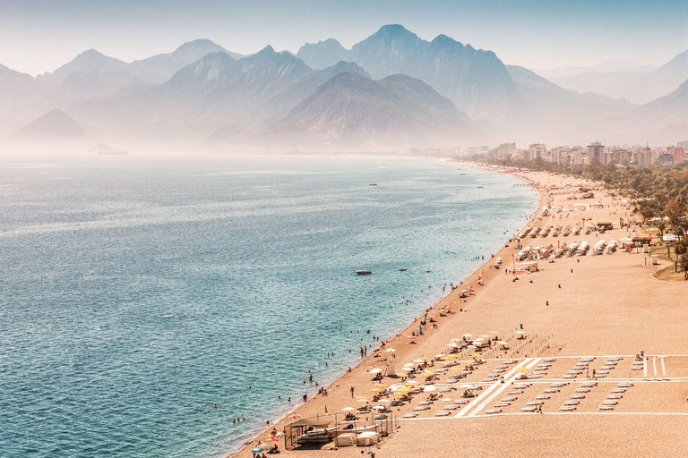 Aerial view of the famous longest Konyaalti beach in Antalya. Vacation and tour on the Mediterranean coast of Turkey