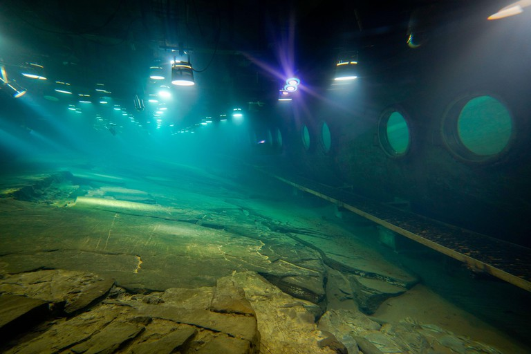 Chongqing, China. 21st Feb, 2021. Photo taken on Feb. 21, 2021 shows the protected reef created about 1,200 years ago to measure the changes in water levels at Baiheliang Museum, China's first underwater museum built about 40 meters below surface in the u