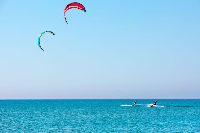Rhodes island, Greece - July, 26, 2019: Kitesurfers on the Prasonisi beach - most femous kitesurfing and windsurfing spot in Rhodes island