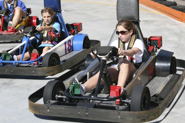 Kids drive low-powered cars with big bumpers at the Track Recreation Center in Destin, Florida. (Photo by Lisa Thatcher Kresl/Dallas Morning News/MCT/Sipa USA)