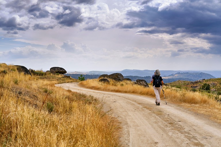 Walking on the granitic high plateau above the Douro river cliffs that make the border with Spain. Lagoaca, Douro Internacional Nature Park, Tras os M