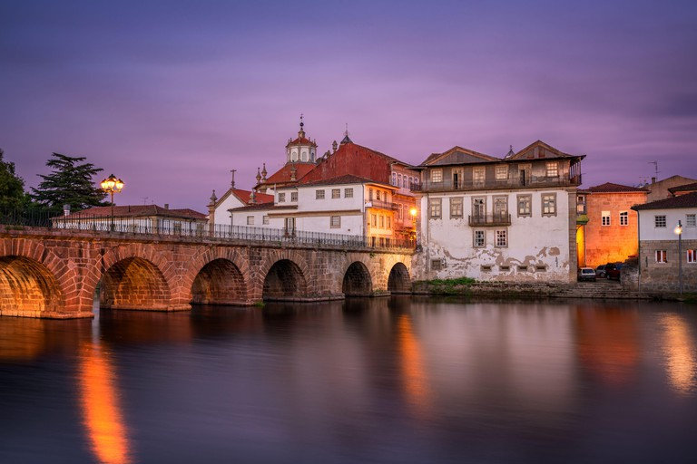 Chaves city view of historic buildings and church at sunset, Portugal