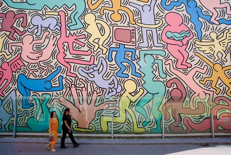 Keith Haring s wall painting Tuttomondo Pisa Tuscany Italy