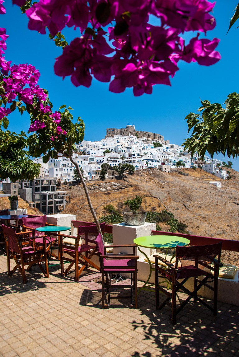 View of Astypalaia island from a colorful cafe. Astypalaia is an aegean island of Greece.