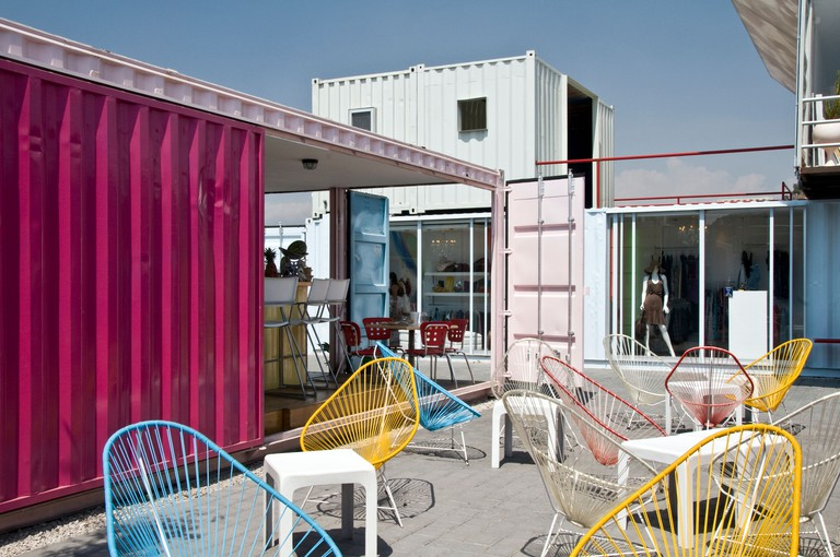 B0D7T0 Cafe at Container City, Cholula, Mexico. A whole town of buildings built from re-used metal containers.
