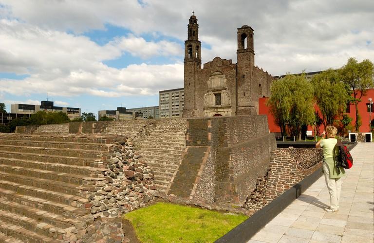 B23D0Y Rear view of woman standing in front of church, Plaza de las Tres Culturas