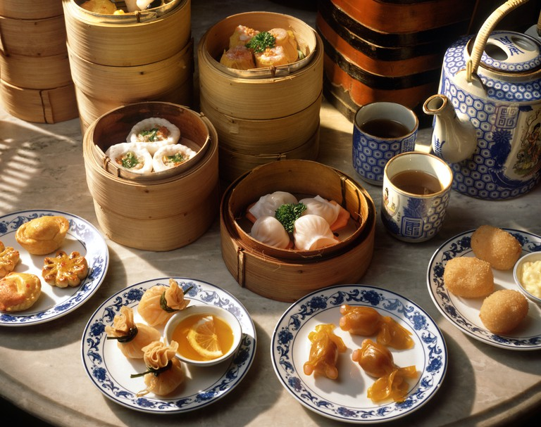 Steamers and plates of dim sum with tea, China, Asia