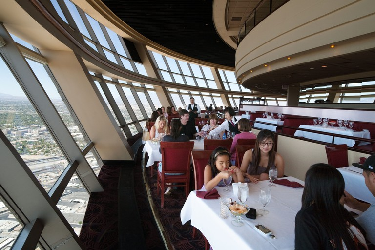 """A family eating in the """"Top of the World"""" revolving restaurant in the Stratosphere Hotel, the Strip, Las Vegas Nevada USA"""