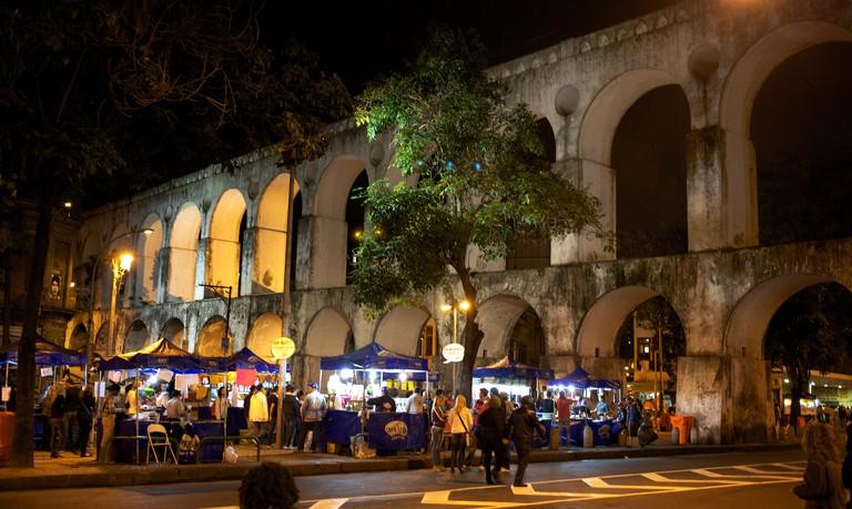 Night life around the Lapa Aquaduct, Rio de Janeiro, a popular location on Friday and Saturday night