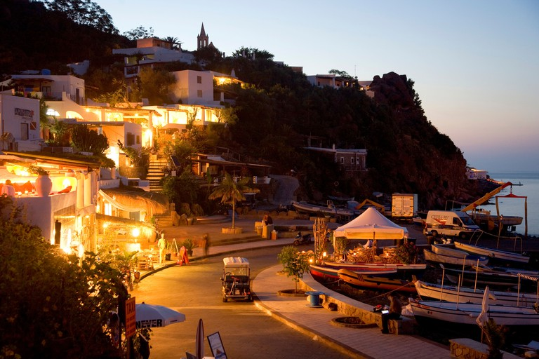 Promenade with restaurants and cafes at night, harbor of Panarea island, Aeolian Islands, Sicily, Italy, Europe