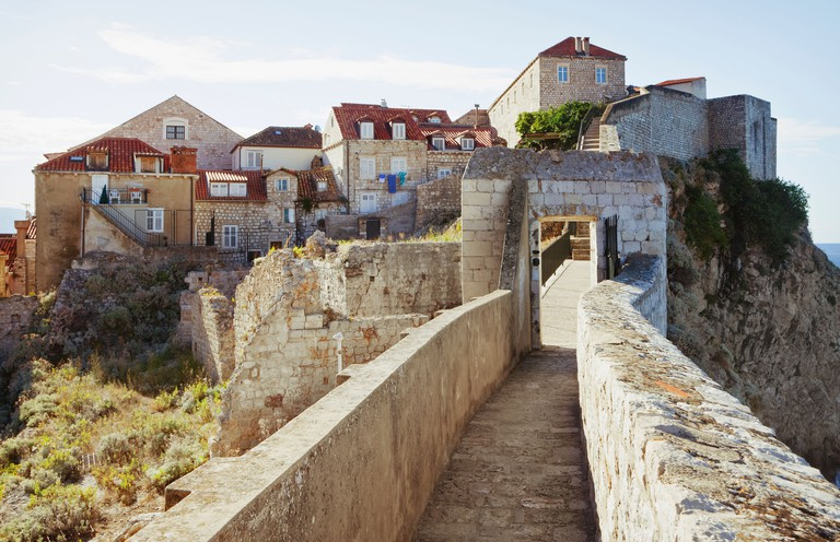 A walkway on the old city walls of the port of Dubrovnik, a UNESCO world heritage site and Adriatic coastal port.