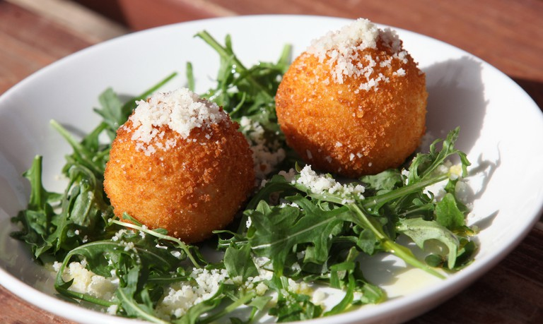 Arancini or arancine fried (or, less commonly, baked) risotto rice balls coated with breadcrumbs, filled with mushrooms
