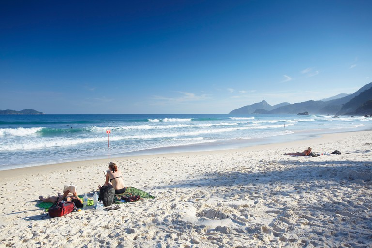 People sunbathing on Lopes Mendes beach, Ilha Grande, Rio de Janeiro State, Brazil, South America